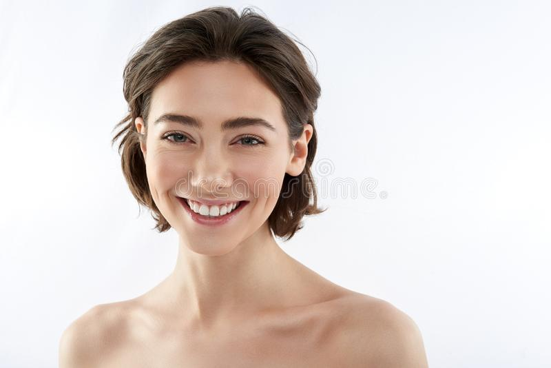 Front view of young happy brunette female royalty free stock photo
