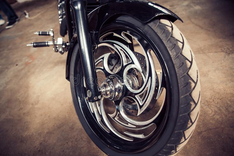 Close up. the front wheel is a cool custom motorcycle. People and their Hobbies stock images