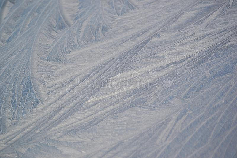 Close-up of frost on a car bonnet. Close-up image of white frost on a silver car bonnet stock photography