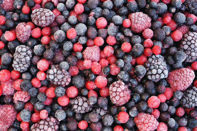 Close up of frozen mixed fruit. Berries - red currant, cranberry, raspberry, blackberry, bilberry, blueberry, black currant royalty free stock photos