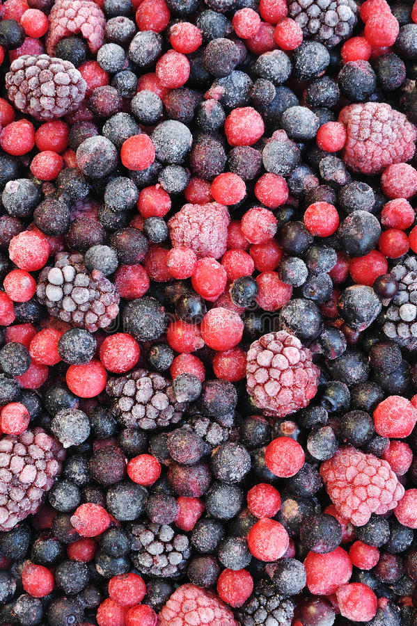 Close up of frozen mixed fruit - berries. Red currant, cranberry, raspberry, blackberry, bilberry, blueberry, black currant royalty free stock photos