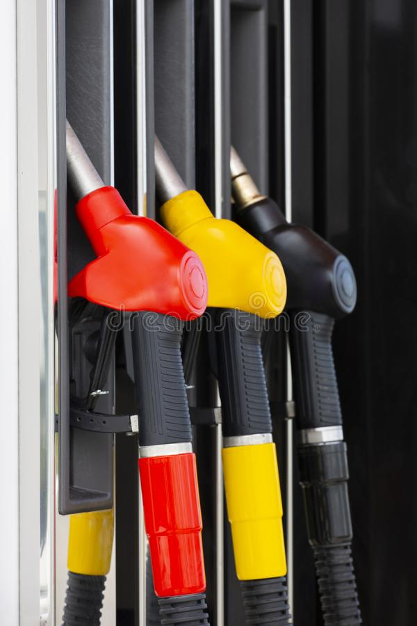 Close-up fuel nozzles on petrol and diesel fuel. Gas station pump. Man refueling gasoline with fuel in a car, holding a nozzle. royalty free stock image