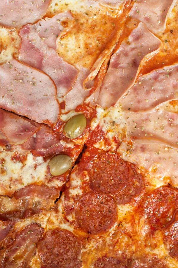 Close-up full frame shot of delicious four seasons pizza. Delicious italian fast food. Top view royalty free stock photos