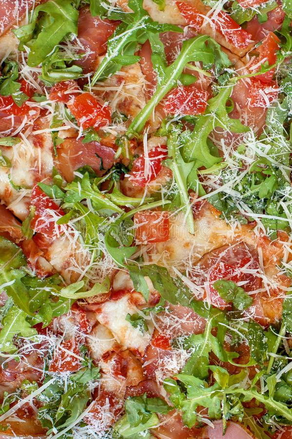 Close-up full frame shot of delicious rucola pizza. Delicious italian fast food. Top view stock photography