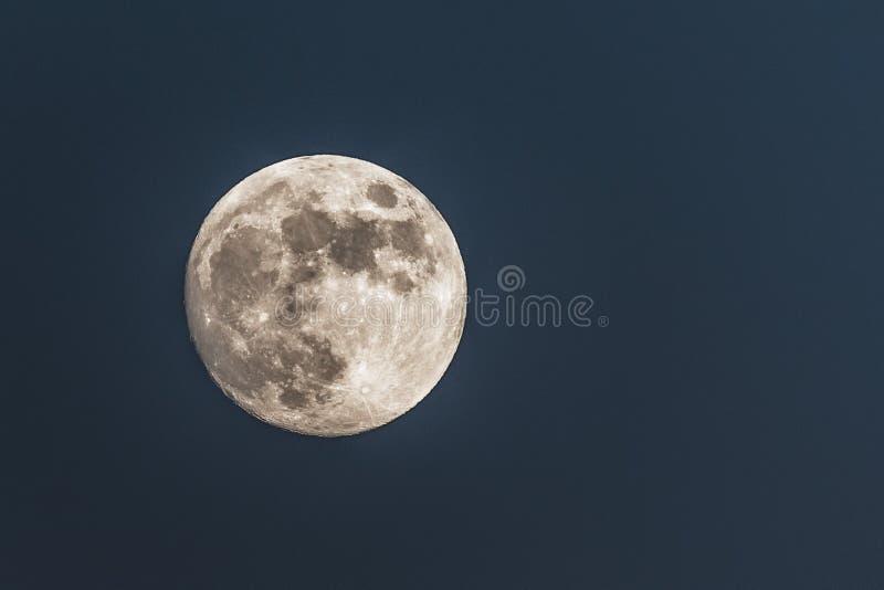 Close up of full moon; dark background stock photos