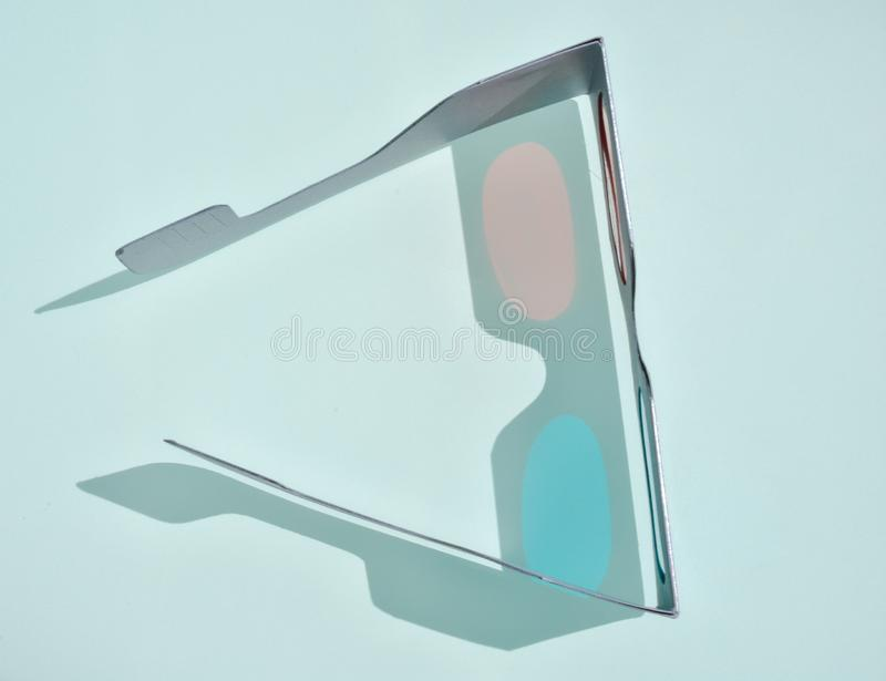 close up of a fun 3d glasses made with cardboard and plastic to create cheap tree optical perception by eyes seeing films at stock image