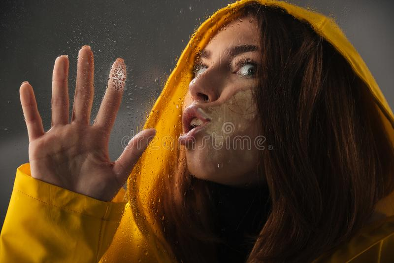 Close up of a funny girl dressed in raincoat royalty free stock photos