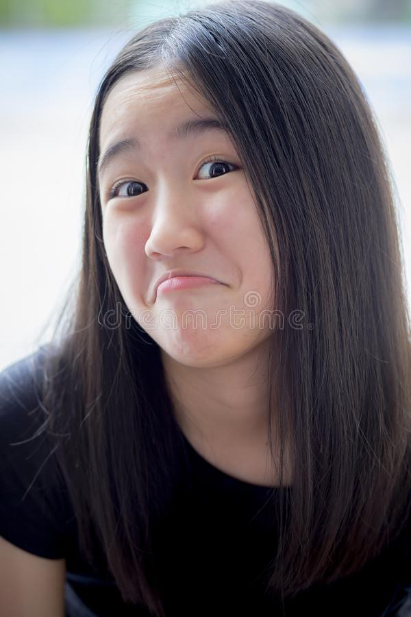 Close up funny kidding face of asian teenager royalty free stock photography
