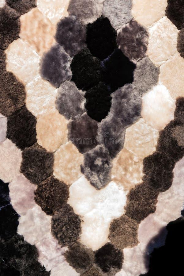 Close up fur carpet made of black, grey and white parts stock photos