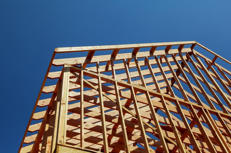 Close-up of gables roof on stick built home under construction and blue sky royalty free stock photo