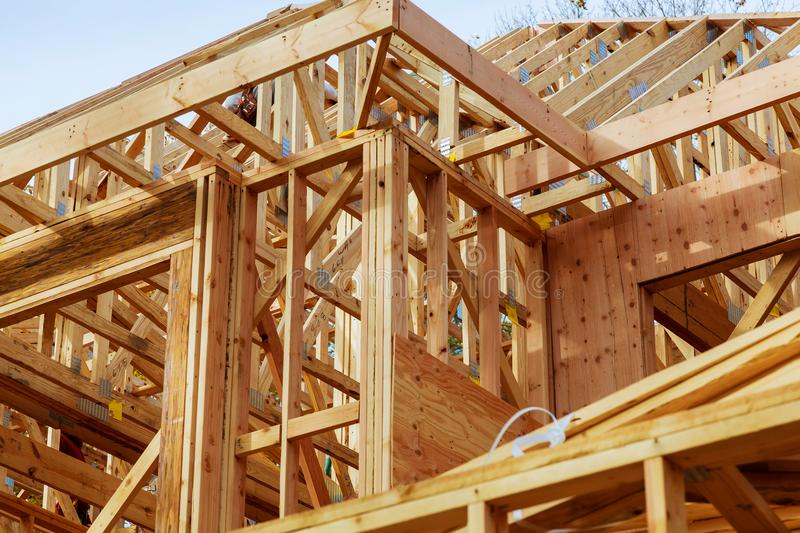 Close-up of gables roof on stick built home under construction New build roof with wooden truss, post and beam framework. royalty free stock photo