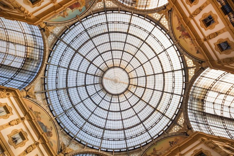 Close up of the Galleria Vittorio Emanuele II arcade with the glass dome in the center. The Galleria is the oldest active shopping royalty free stock image