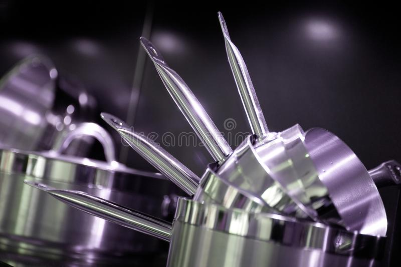 Close-up of Stainless steel casserole set royalty free stock photos