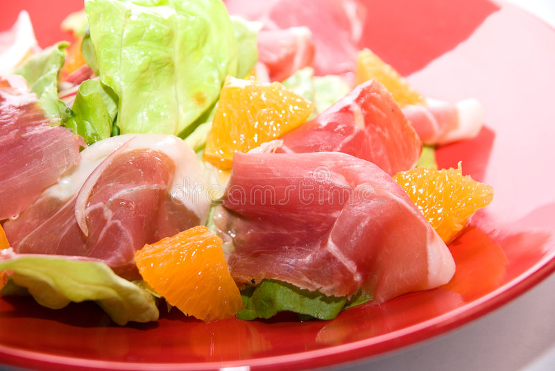 Close up of gammon salad. At red dish on white royalty free stock image