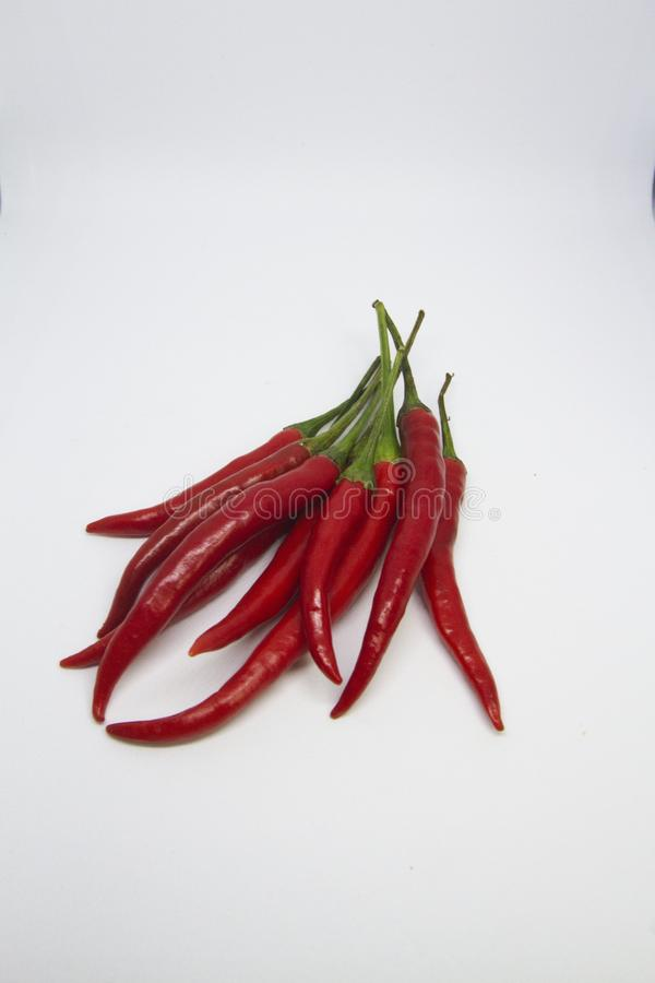 Close-up of chili peppers on white background stock photo