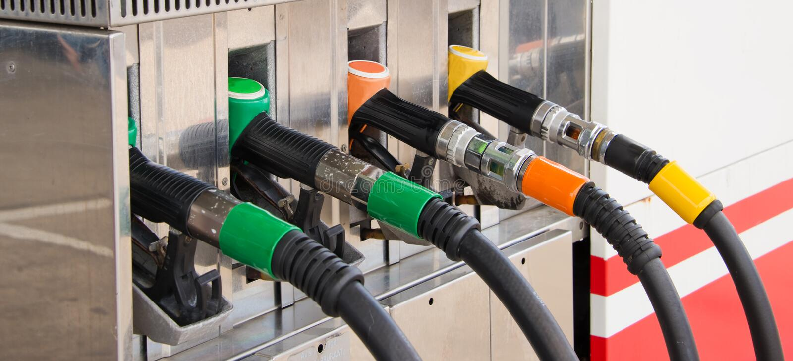 Close up of gas pump nozzles. Panoramic royalty free stock images