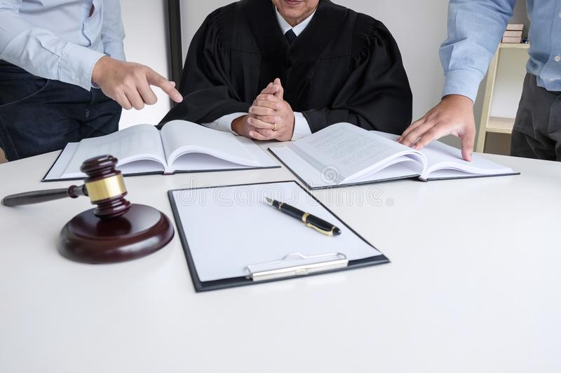 Close up of gavel, Male lawyer and older judge Consult with client on the case and working with Law books, report the case on tab. Le in modern office, Law and stock image