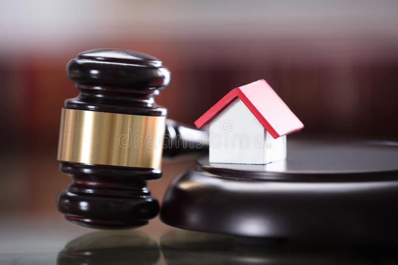 Gavel With Small House Model stock photos