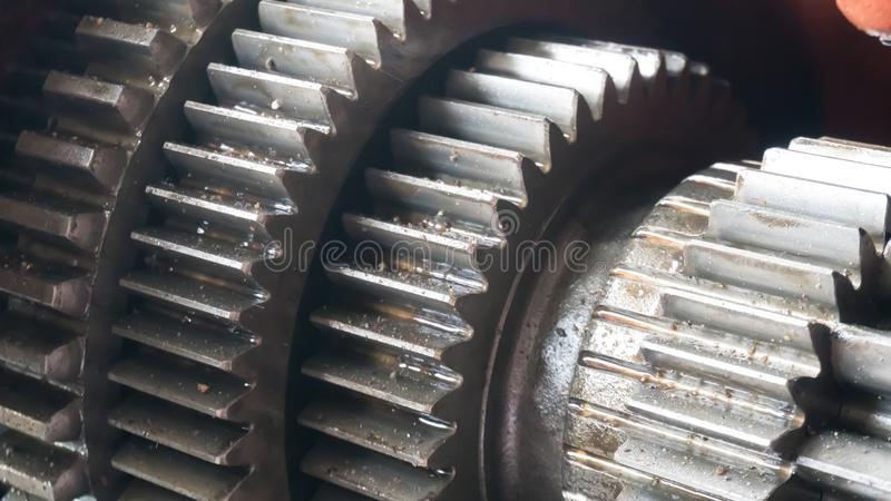Close up gear wheel rotate concept. spare part of vehicle car. Fix car royalty free stock photography