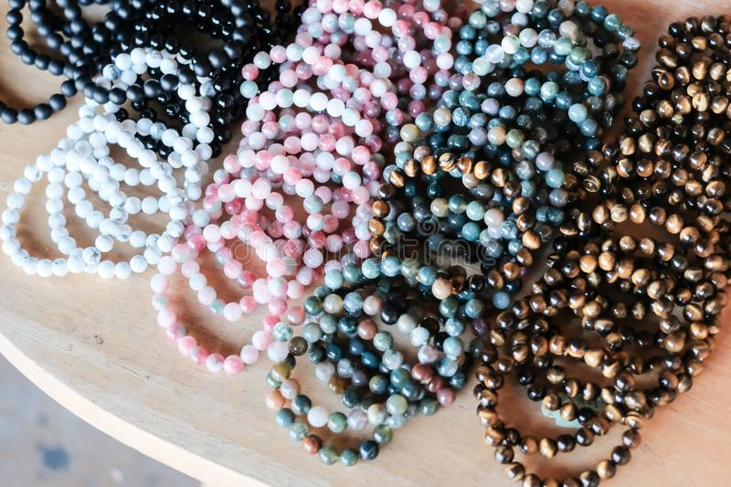 Close up of gemstone bracelets in the street market. royalty free stock photos