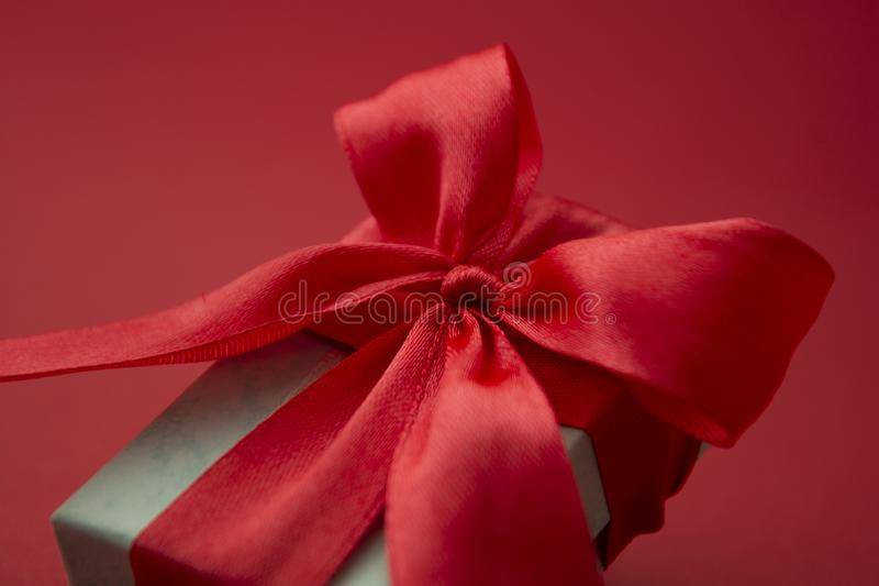 Close up gift box, birtday gift with red bow on red background. Love, Valentine& x27;s Day, Mother& x27;s Day. Close up gift box, birtday gift with red bow on royalty free stock images