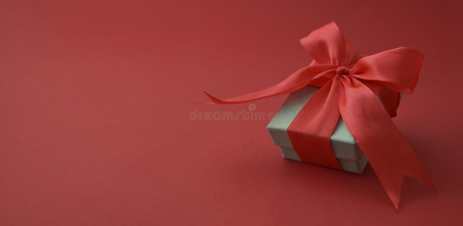 Close up gift box, birtday gift with red bow on red background. Love, Valentine's Day, Mother's Day. Banner. Close up gift box, birtday gift with red royalty free stock images