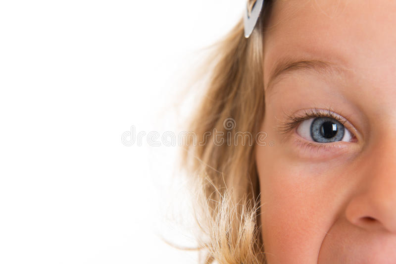 Close up of a girl with blue eyes. In front of white background royalty free stock image