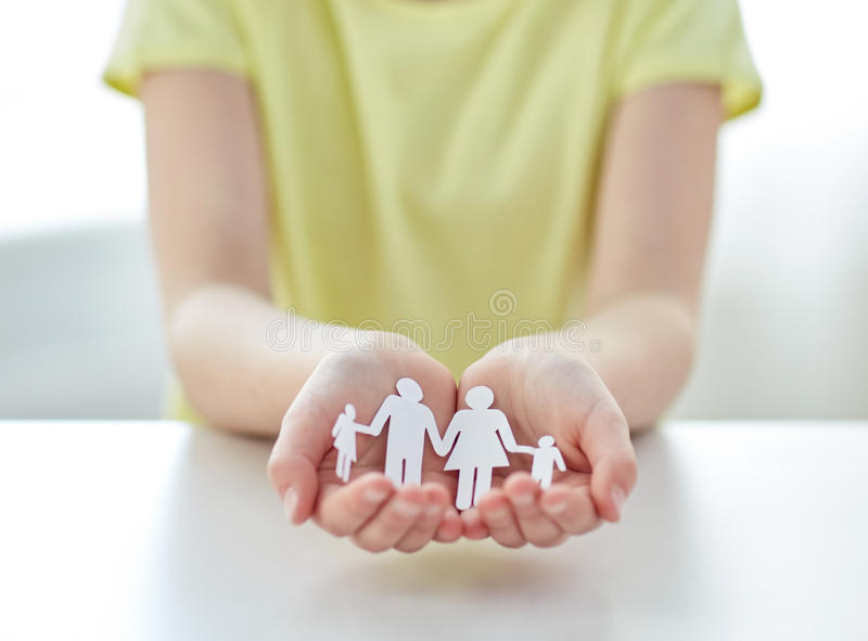 Close up of girl hands with paper family cutout royalty free stock photography