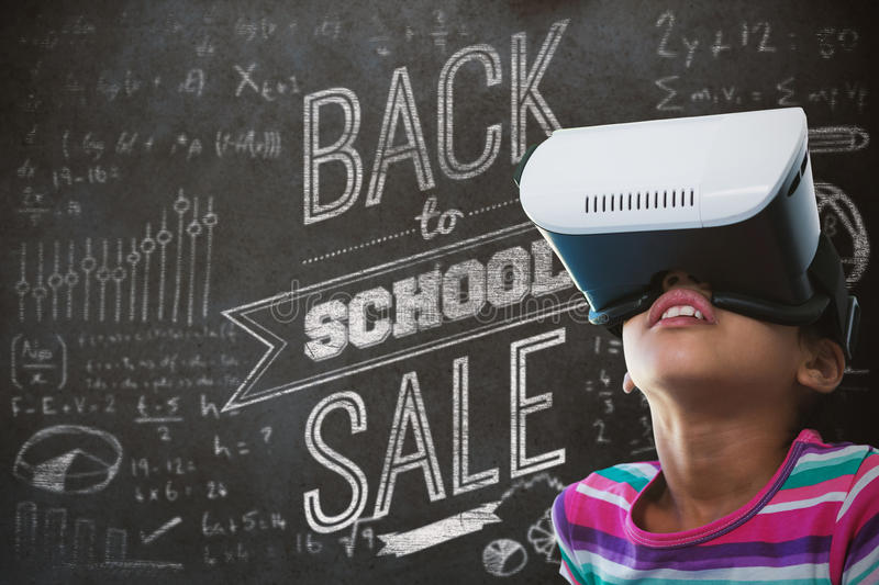 Composite image of close up of girl using virtual reality simulator stock photography