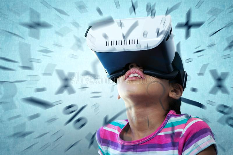 Composite image of close up of girl using virtual reality simulator stock images
