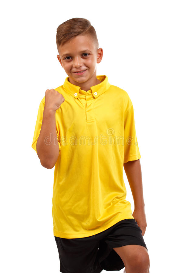Close-up of a glad boy who won the championship. A cheerful child in a football uniform isolated on a white background royalty free stock photography