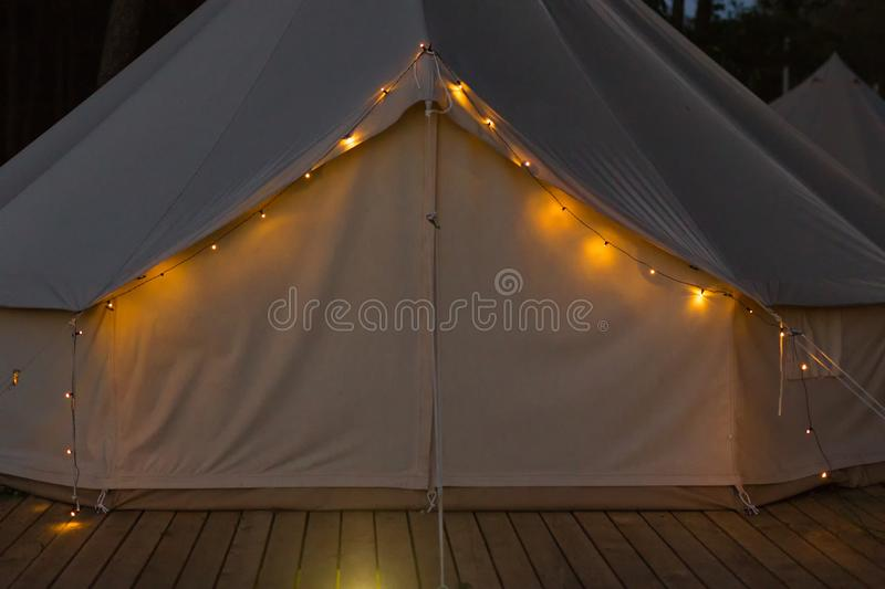 Close-up of glamping bell tent at night. Front view royalty free stock images