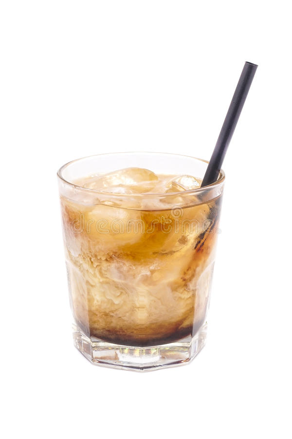 Close up of glass with alcohol russian cocktail with rum, cola and white creamy milk. royalty free stock photos