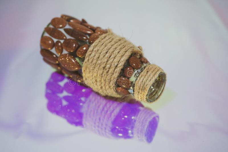 Close up of the glass bottle, with purple reflection stock photos