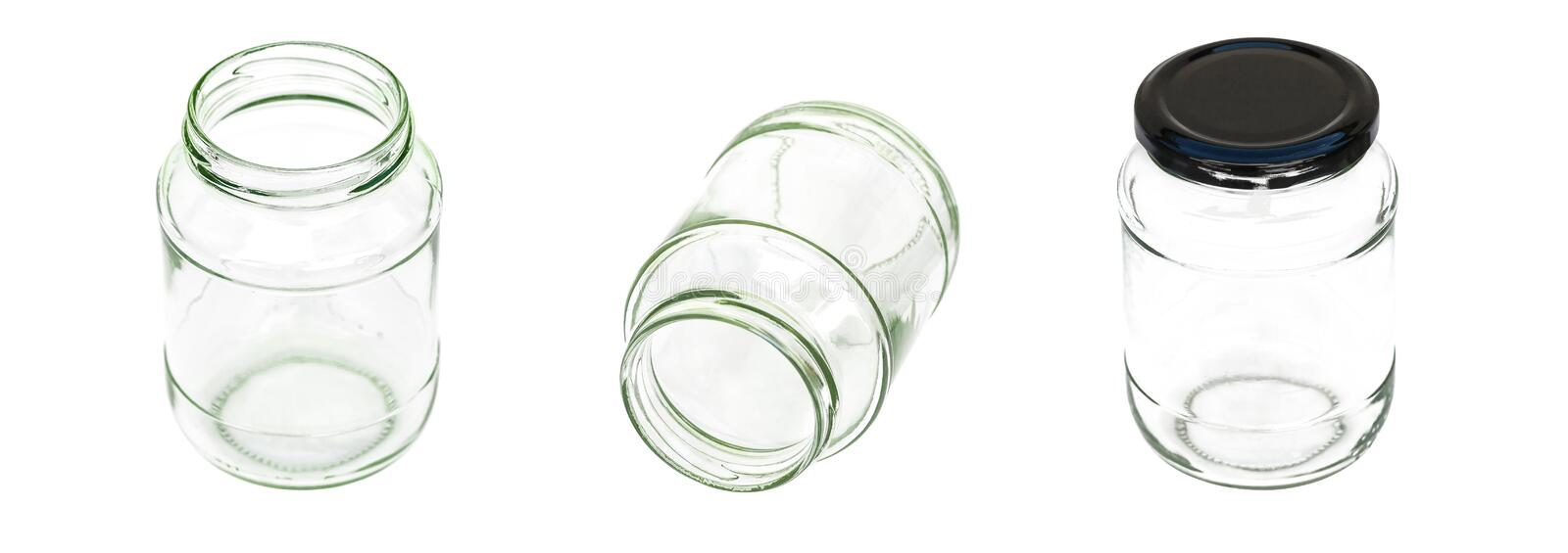 Close up glass bottle transparent blank with black lid isolated on white background. stock images