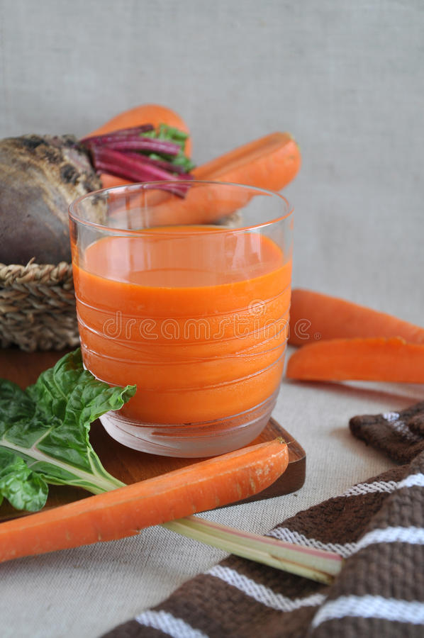 Close up Glass of Fresh Carrot Juice stock photo