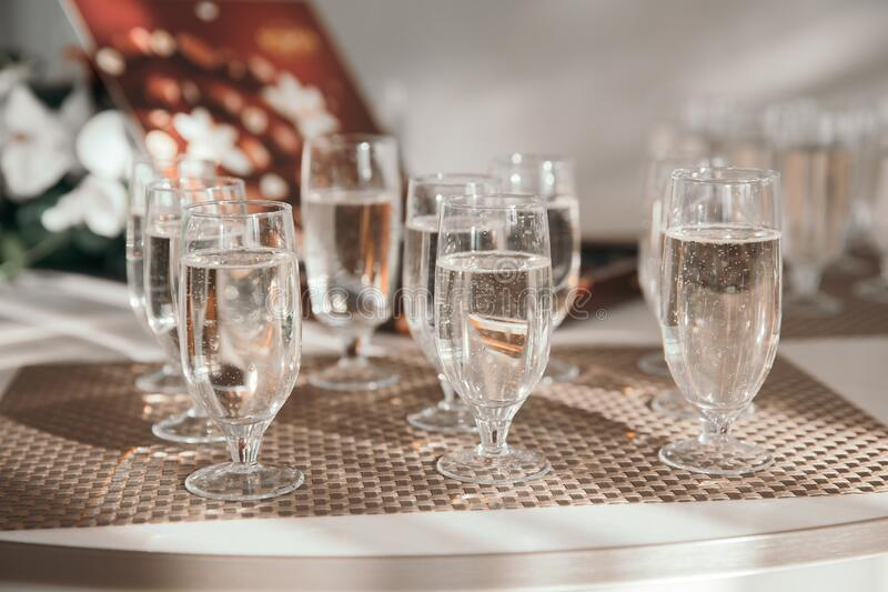 Close up. glasses of champagne on the holiday table. royalty free stock images