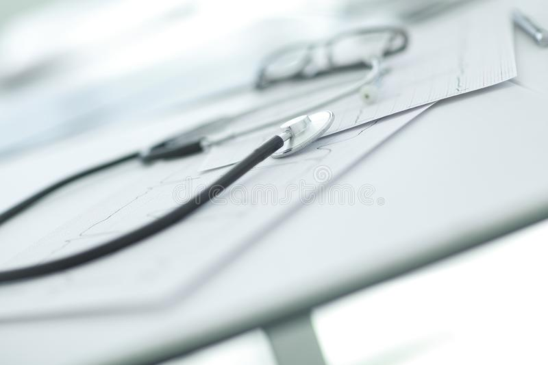 Close up. glasses and a stethoscope on the therapist`s Desk. Photo with copy space royalty free stock photos