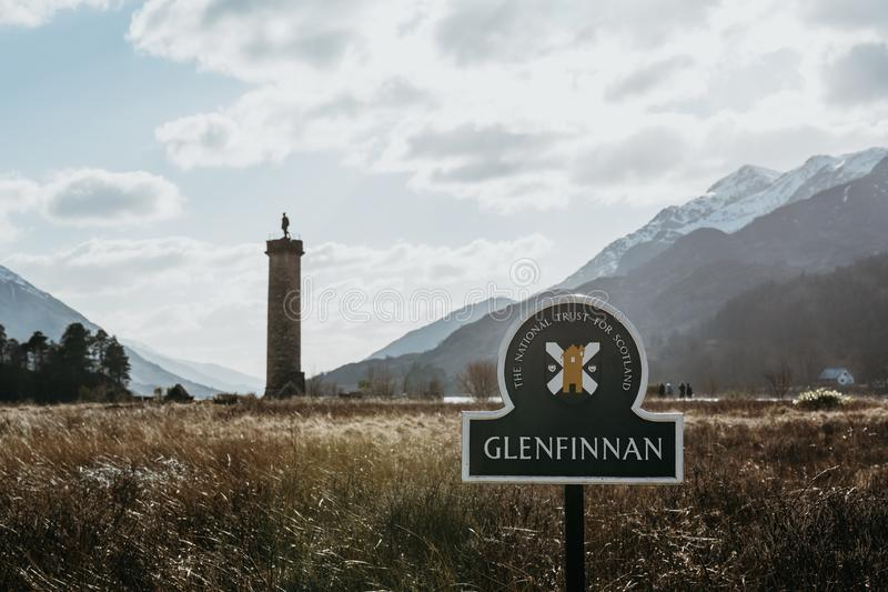 Close up of Glenfinnan sign, Glenfinnan Monument on the background, Scotland, UK. stock image