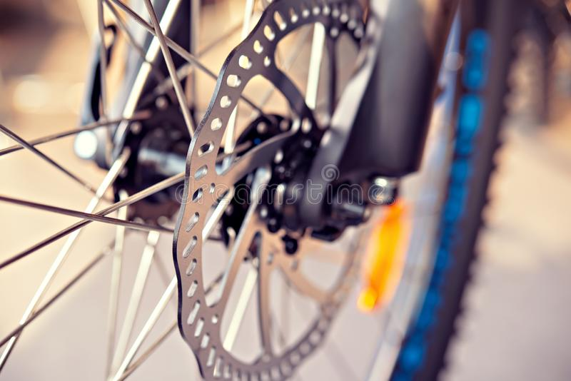 Close up of bicycle disk break. Close up of a glossy bicycle disc break stock photos