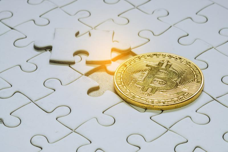 Close up gold bitcoin and Final piece of jigsaw puzzle. royalty free stock photos