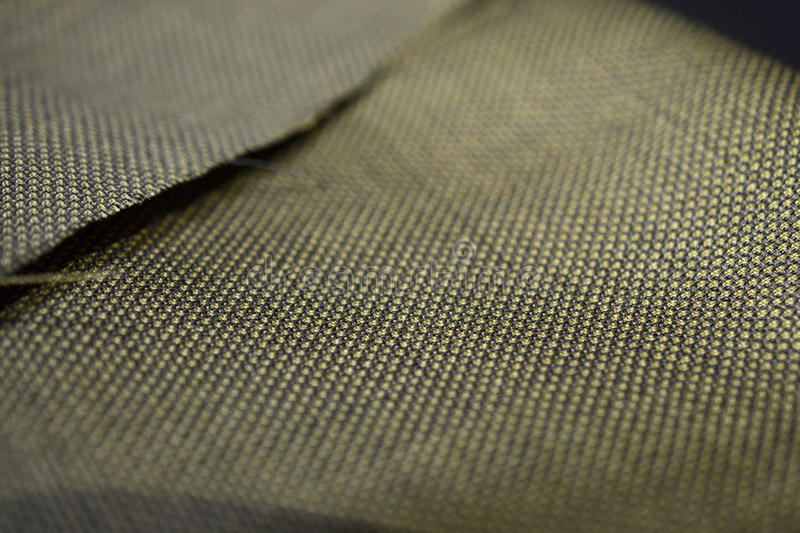 Close up gold with black pattern texture of suit. Photo shoot by depth of field for object royalty free stock photography