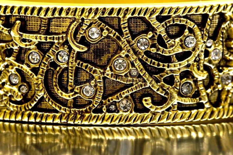 Close-up of gold bracelet. With diamonds royalty free stock photos