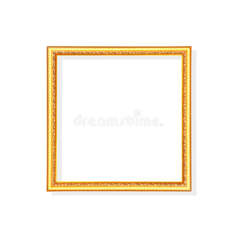 Gold or bright yellow picture frame with carving in leaves patterns isolated on white background with clipping path stock photography