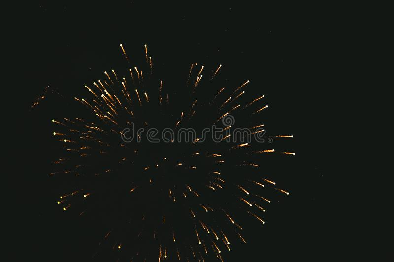 Close-up gold festive fireworks on a black background. Abstract holiday background. Victory day. 9 March 2019 stock photos