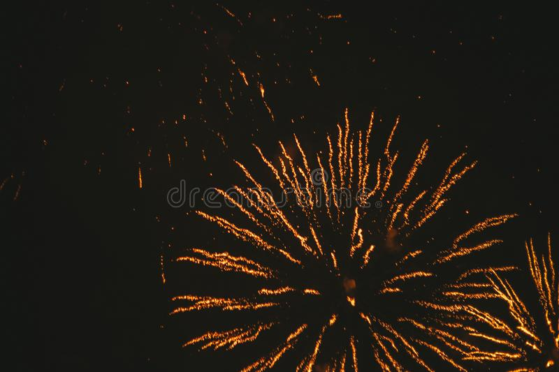 Close-up gold festive fireworks on a black background. Abstract holiday background. Victory day. 9 March 2019 stock images
