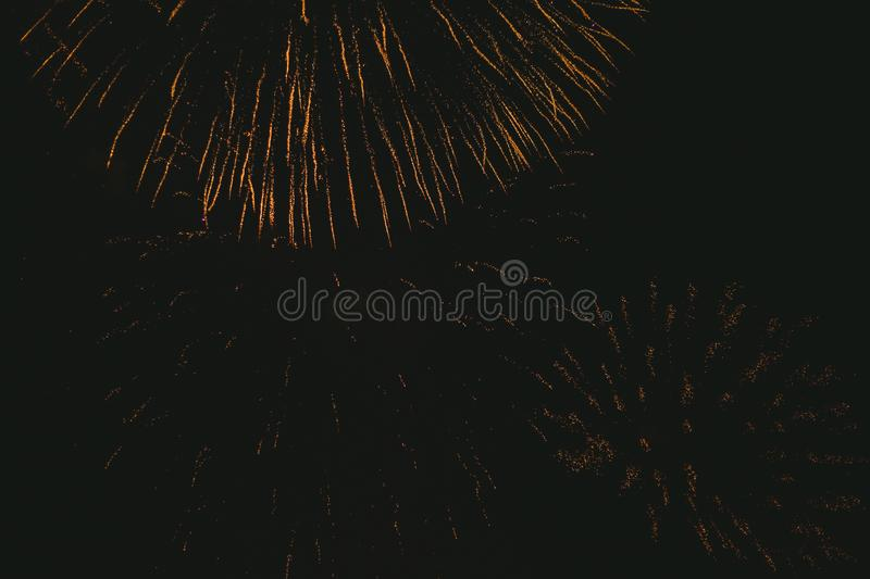 Close-up gold festive fireworks on a black background. Abstract holiday background. Victory day. 9 March 2019 royalty free stock images