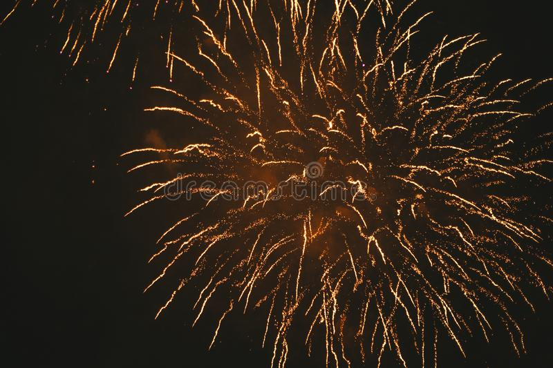 Close-up gold festive fireworks on a black background. Abstract holiday background. Victory day. 9 March 2019 royalty free stock photography