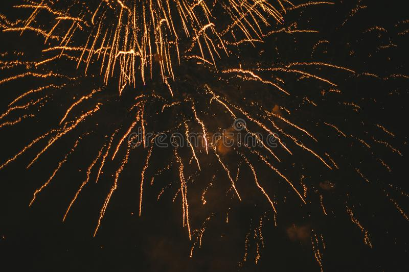 Close-up gold festive fireworks on a black background. Abstract holiday background. Victory day. 9 March 2019 stock image