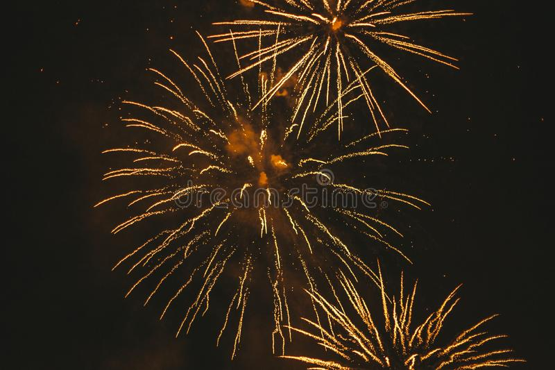 Close-up gold festive fireworks on a black background. Abstract holiday background. Victory day. 9 March 2019 royalty free stock photo